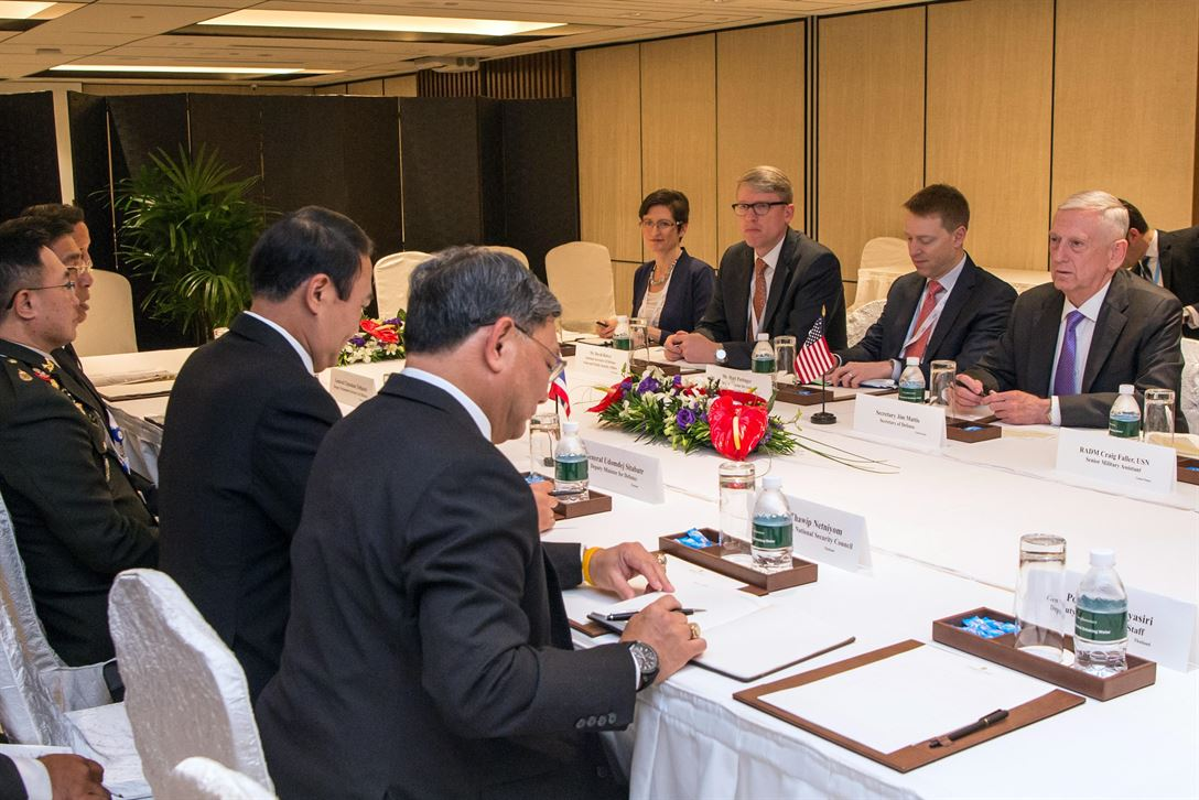 Defense Secretary Jim Mattis meets with Gen. Udomdej Sitabutr, Thailand's deputy defence minister, during the Shangri-La Dialogue in Singapore, June 3, 2017. DoD photo by U.S. Air Force Staff Sgt. Jette Carr