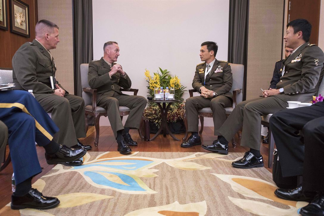 Marine Corps Gen. Joe Dunford, chairman of the Joint Chiefs of Staff, speaks with Singapore chief of staff, Army Lt. Gen. Perry Lim Cheng Yeow, during a bilateral meeting at  the Shangri-La Dialogue in Singapore, June 3, 2017. DoD photo by Navy Petty Officer 2nd Class Dominique A. Pineiro