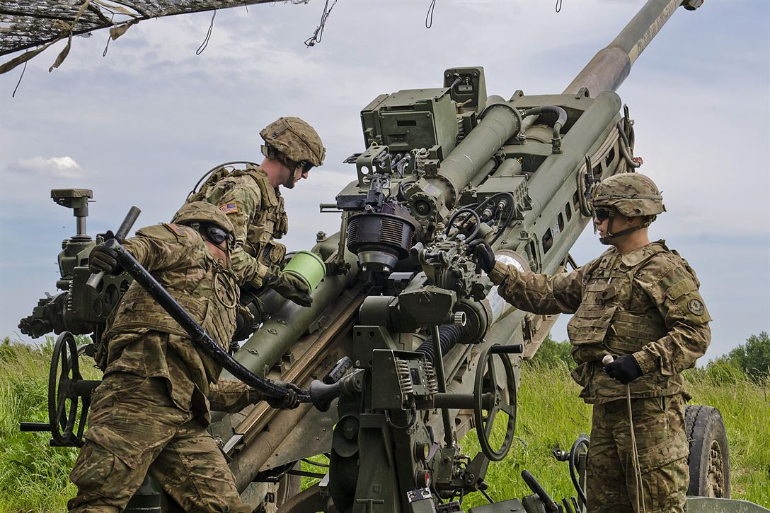 Soldiers load an M777A2 howitzer to prepare for a fire mission at Land Forces Field Training Center in Bemowo Piskie, Poland, June 6, 2017, as part of Saber Strike 17, a U.S. Army Europe-led multinational combined forces exercise. Army photo by Sgt. Justin Geiger