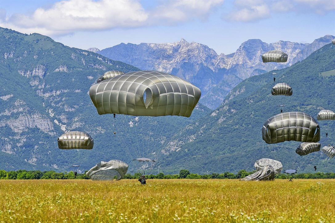 Army paratroopers descend on Juliet drop zone in Pordenone, Italy, June 8, 2017, after jumping from an Air Force C-130 Hercules during airborne operations. The paratroopers are assigned to the 2nd Battalion, 503rd Infantry Regiment. Army photo by Davide Dalla Massara