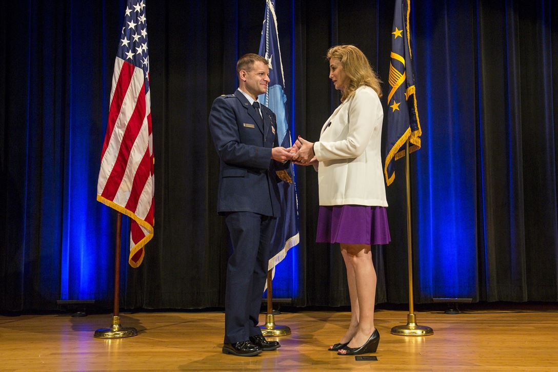 Air Force Maj. Bryan Fram presents a Department of Defense Pride Civilian Leadership Award to Amanda Simpson, former deputy assistant secretary of defense for operational energy, during an award ceremony marking LGBT Pride Month at the Pentagon, June 12, 2017. Army photo by Zane Ecklund